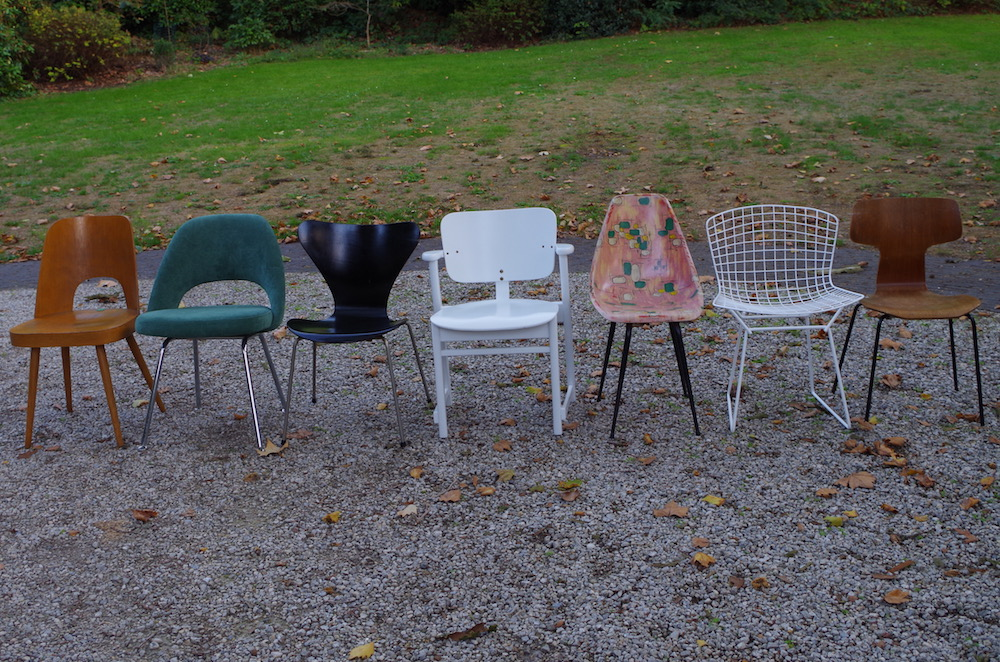 mix of vintage design chairs, tapiovaara, saarinen, jacobsen, bertoia